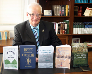 hughes-with-books-nov16
